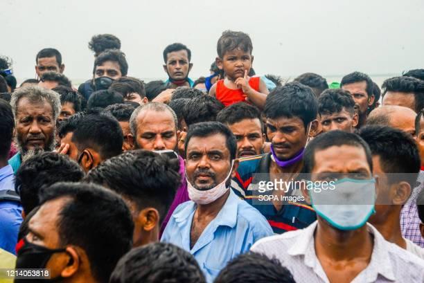 Migrant people on an overcrowded ferry travel home for Eid al-Fitr celebrations amid Coronavirus crisis. Migrants flock at the Shimulia-Kathalbari...
