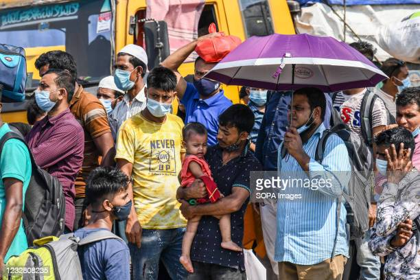 Migrant people wait for a ferry to get home to celebrate Eid al-Fitr amid coronavirus crisis in Munshiganj on the outskirts of Dhaka. Despite the...