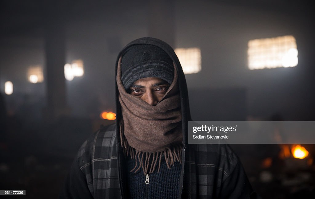 A migrant poses for a picture inside a derelict customs warehouse on January 11, 2017 in Belgrade, Serbia. It is estimated that around 1, 000 migrants are sleeping rough in Serbia, enduring temperatures as low as 20 degrees celcius.