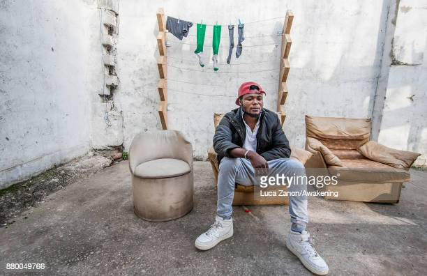 A migrant poses for a portrait in the 'CAS' center at the Caracol cooperative on November 27 2017 in Venice Italy The Caracol center hosts only...