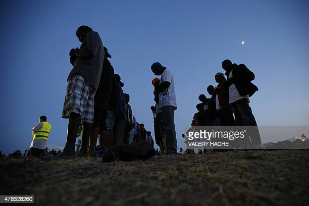 Migrant pray near the sea in the city of Ventimiglia on the FrenchItalian border on June 24 2015 Italy warned today that EU solidarity is at stake if...