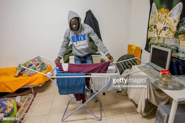 A migrant puts clothes to dry in his room in the 'CAS' center at the Caracol cooperative on November 27 2017 in Venice Italy The Caracol center hosts...