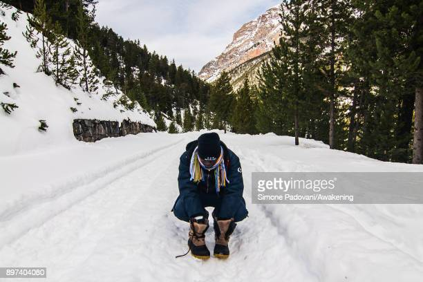 A migrant rests climbing Colle della Scaladuring another attempt to reach the French border on December 22 2017 in Bardonecchia Turin Italy After the...