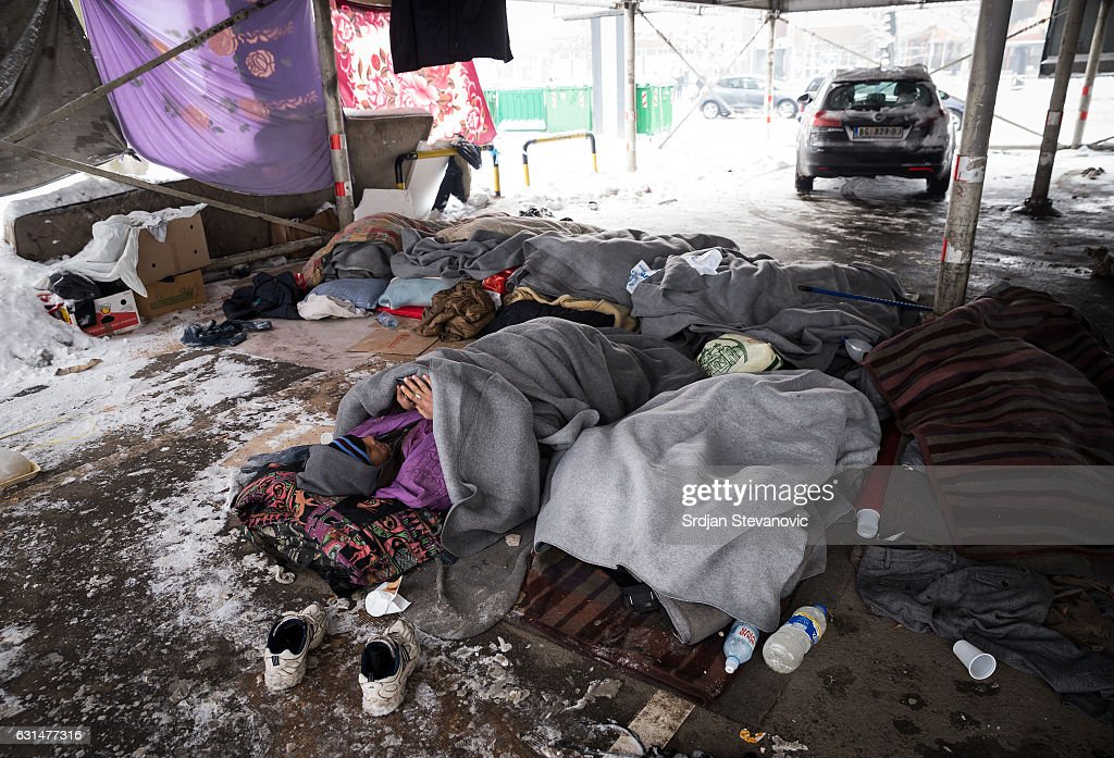 A migrant rests in a public garage on January 11, 2017 in Belgrade, Serbia. It is estimated that around 1, 000 migrants are sleeping rough in Serbia, enduring temperatures as low as 20 degrees celcius.