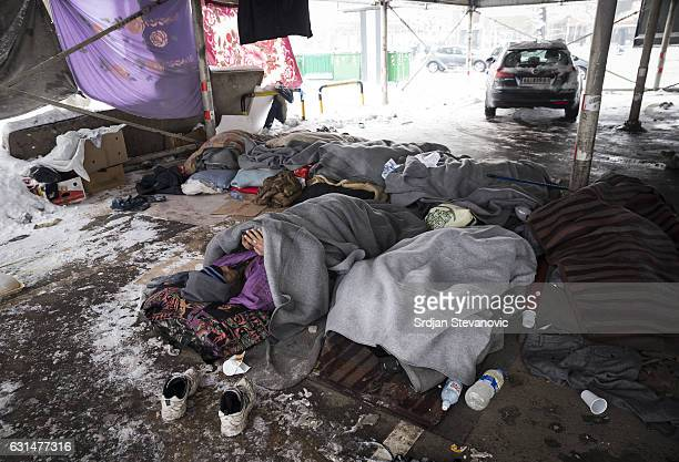 A migrant rests in a public garage on January 11 2017 in Belgrade Serbia It is estimated that around 1 000 migrants are sleeping rough in Serbia...