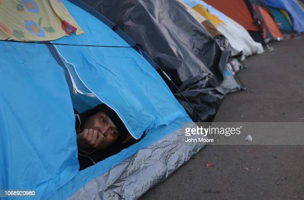 A migrant rests in his tent in a camp on December 5 2018 in Tijuana Mexico Now near the USMexico border after traveling more than six weeks from...