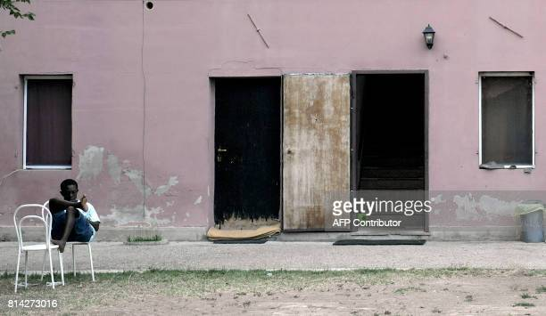 A migrant sits at a reception centre in Bagnoli di Sopra on July 10 2017 They used to be sleepy hamlets on Italy's sunbaked Padan Plain But two years...