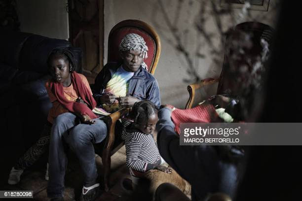 RENAUD A migrant sits with children in the house of Francoise Cotta a French citizen who hosts migrants arriving illegally from Italy on October 25...