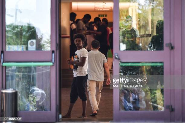Migrant stands at the entrance to the Catholic Church center 'Mondo Migliore' in Rocca di Papa, near Rome, on August 29, 2018. - Some 100 refugees...