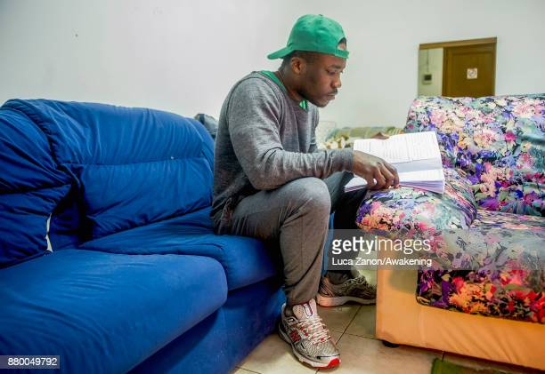 A migrant studying Italian in his room in the 'CAS' center at the Caracol cooperative on November 27 2017 in Venice Italy The Caracol center hosts...