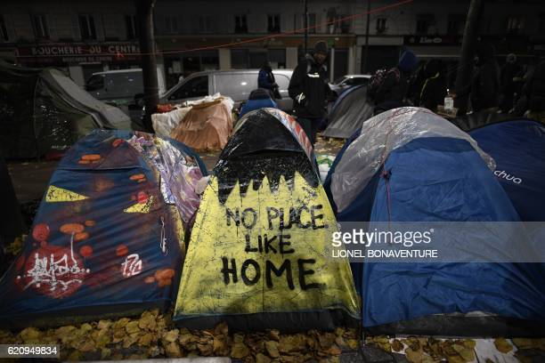 TOPSHOT Migrant tents are seen on the Avenue de Flandre during an evacuation of a makeshift camp in Paris on November 4 one of several camps...