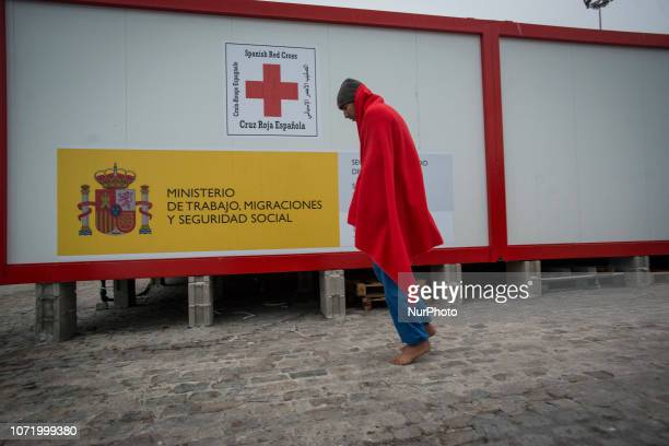 A migrant walking towards the Care unit On 7 December 2018 in Malaga Spain The Spanish Maritime vessel the quotSAR Masteleroquot rescued 130 migrants...
