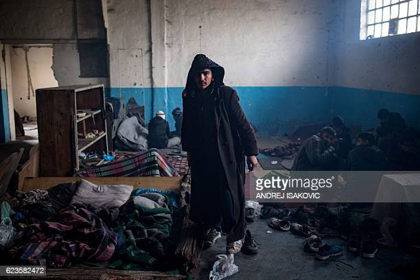Migrant walks in a makeshift shelter in an abandoned warehouse in Belgrade on November 16, 2016. Hundreds of thousands of migrants had passed through...