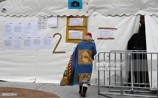 A migrant walks to a waiting tent to register at the State Office of Health and Social Affairs centre in Berlin on January 4 2016 Germany only has...