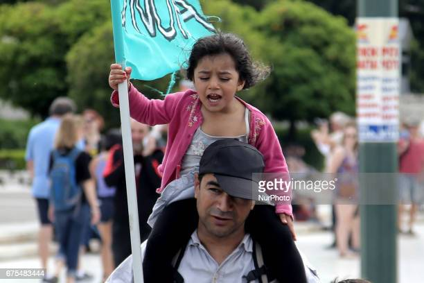 A migrant with his child protest against closed borders during the May Day celebrations on Monday May 1st 2017 More than 10000 protesters took part...