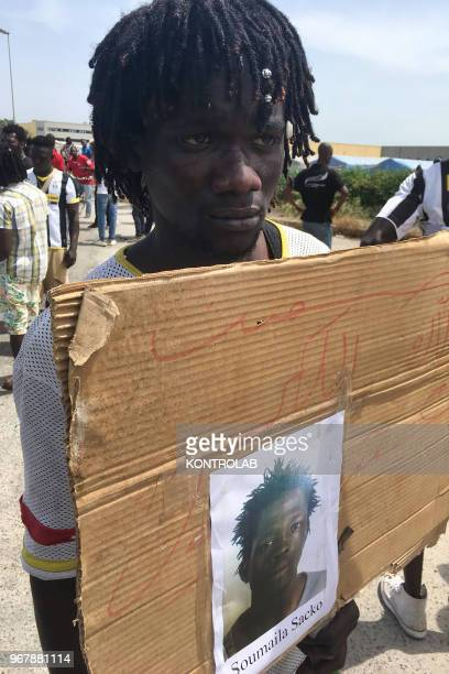 Migrant with the photo of Soumayla Sacko during the protest over the death of Soumayla Sacko, the 29-year-old Malian migrant who was shot and killed...