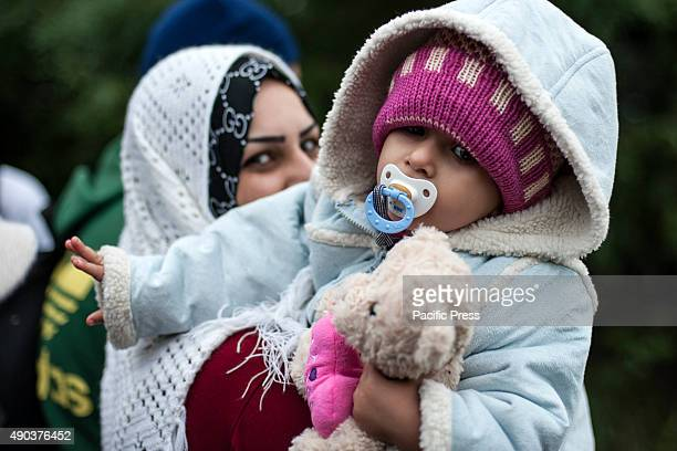 BORDER BAPSKA SYRMIA CROATIA Migrant woman and her child waiting to cross the border to get in Croatia More and more refugees arrive in Europe...