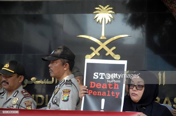 Migrant worker activists demonstrated in front of the Saudi Arabian Embassy office in Jakarta protesting the execution of a beheading sentence...