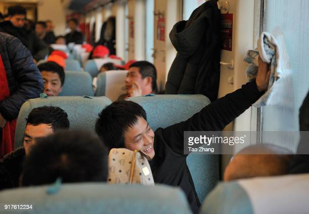Migrant Worker cleans window at the original K48 train starting from Hangzhou and ending Qiqihar on 13 February 2018. Northeast China's Heilongjiang...
