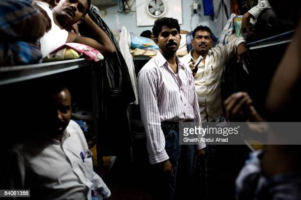 Migrant worker crowd into bunk beds July 19 2008 in Old Dubai United Arab Emirates Workers live and work without adequate rights in difficult...