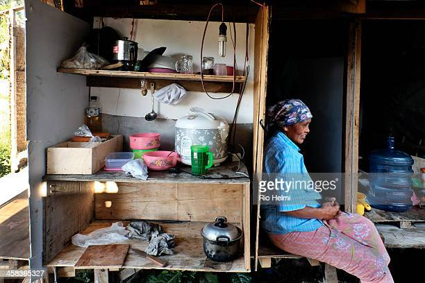 LODTUNDUH UBUD BALI INDONESIA A migrant worker from Java on a building site looks after the makeshift kitchen and the cooking for the workers...