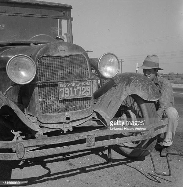 Migrant worker from Oklahoma repairing tire on California highway By Dorothea Lange 18951965 dated 19360101 Feb