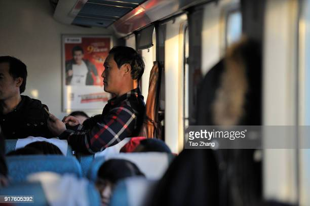 Migrant Worker stand at the original K48 train starting from Hangzhou and ending Qiqihar on 13 February 2018. Northeast China's Heilongjiang province...
