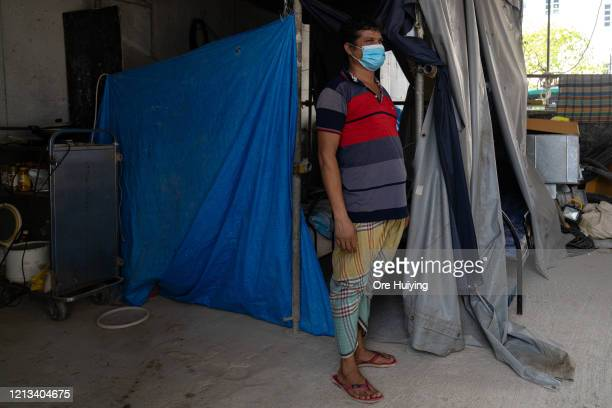 Migrant worker stands outside his sleeping quarter in a construction site on May 17, 2020 in Singapore.