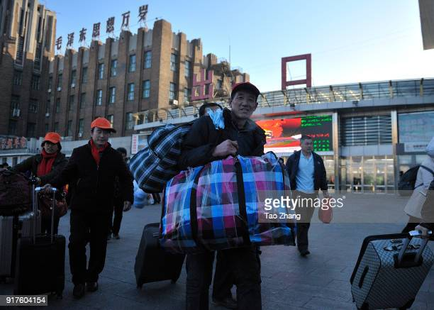 Migrant Workers carry their luggage through Qiqihar Railway Station on 13 February 2018. Northeast China's Heilongjiang province launched a special...