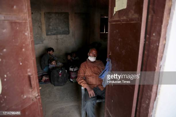 Migrant workers from Bihar waiting in a ramshackle room for a bus to take them back from a temporary shelter home at Kanota on Agra highway, on May...