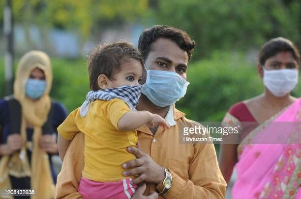 Migrant workers head back to their hometowns and villages on foot on day 3 of the three week nationwide lockdown to check the spread of Coronavirus...
