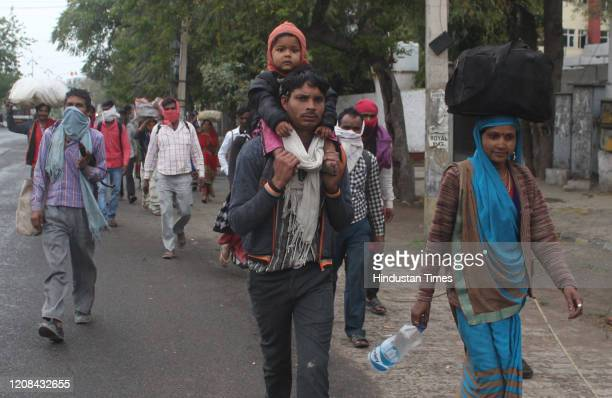 Migrant workers head to their homes in Madhya Pradesh on the third day of the national lockdown imposed by Prime Minister Narendra Modi to curb the...
