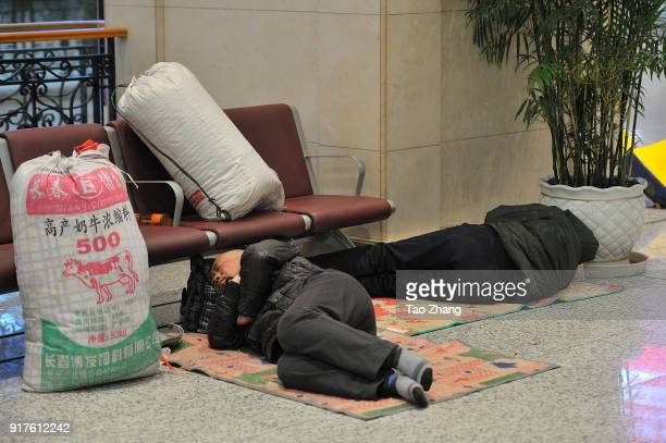 Migrant Workers sleeping at Harbin Railway station in Harbin of China on 13 February 2018. A total of 2.98 billion trips are expected to be made...