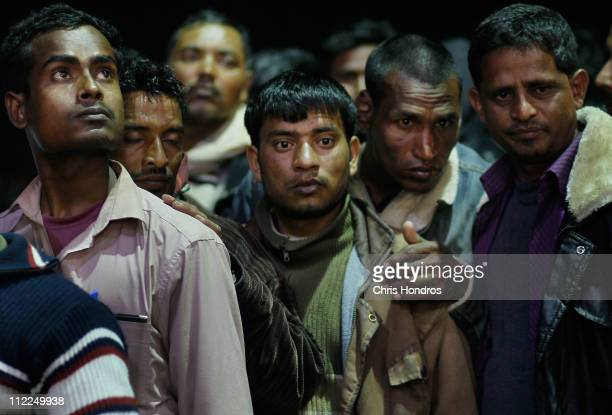 Migrant workers stand huddled together waiting to disembark a ship that evacuated them from the besieged city of Misrata April 15 2011 in Benghazi...