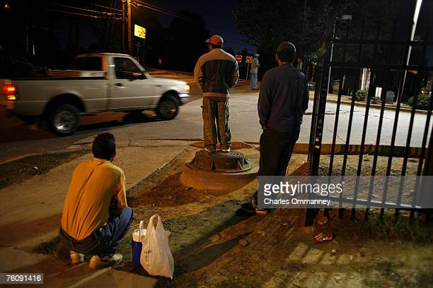 Migrant workers start gathering as early as 5:00 am every morning on the corner of Northwood and Roswell streets October 16, 2005 in Silver Springs,...