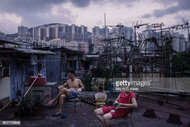 Migrant workers take a break after dinner outside the rooftop hut on June 3 2017 in Hong Kong Hong Kong Hong Kong is marking 20 years since the...
