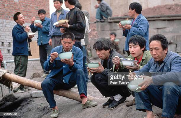 Migrant Workers Taking a Break to Eat