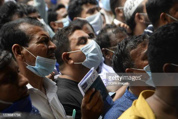 Migrant workers waiting for air tickets in front of Biman Bangladesh Airlines office to return to their workplaces in time. Hundreds of Migrant...