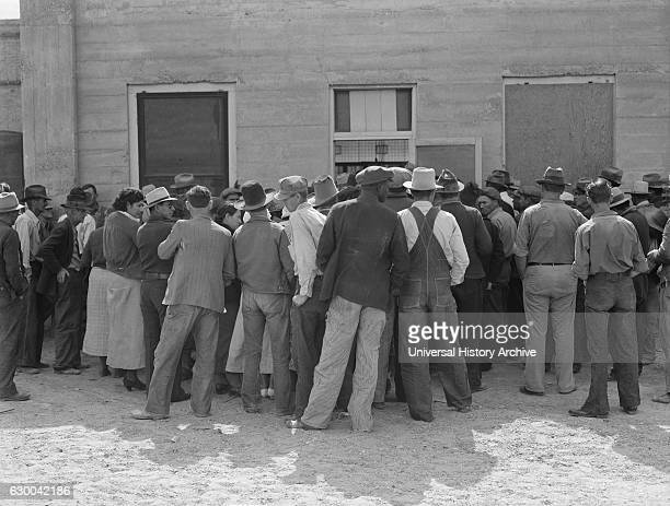 Migrant Workers Waiting for Relief Checks, Calipatria, California, USA, Dorothea Lange for Farm Security Administration, February 1937.