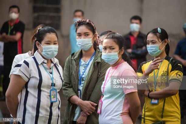Migrant workers waiting for saliva-based Covid-19 test at Bangkok Fish Marketing Organization during a Covid-19 screening and testing following a new...