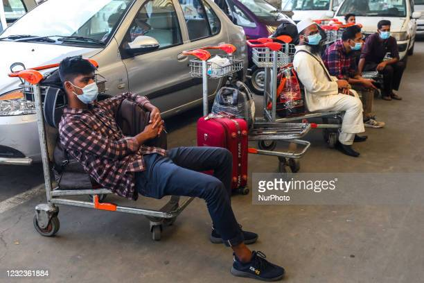 Migrant workers waits for the flights as those are cancelled as authorities concerned of the respective destinations Riyadh, Dammam, Dubai, and...