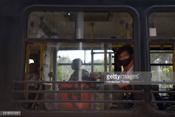 Migrants aboard a bus after registering with the Delhi government at Delhi Pharmaceutical Sciences and Research University at Pushp Vihar on May 18...