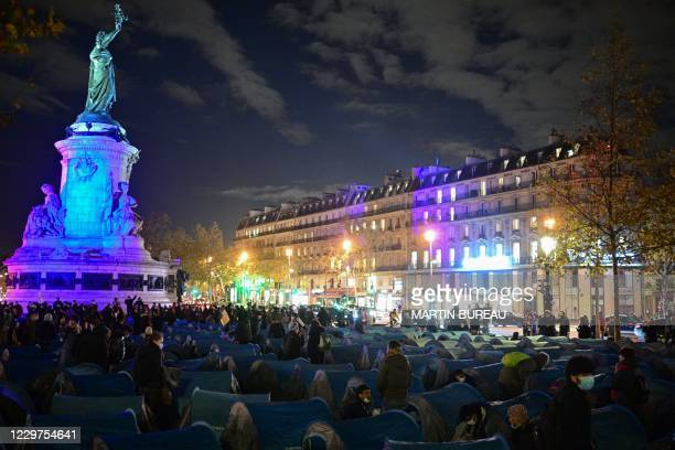 Migrants and associations install tents on Republique square in Paris on November 23 one week after migrants were evacuated from a makeshift camp in...