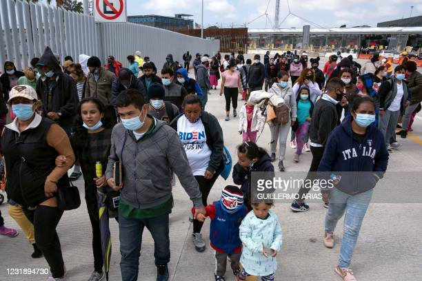 Migrants and asylum seekers awl after a demonstration at the San Ysidro crossing port asking US authorities to allow them to start their migration...