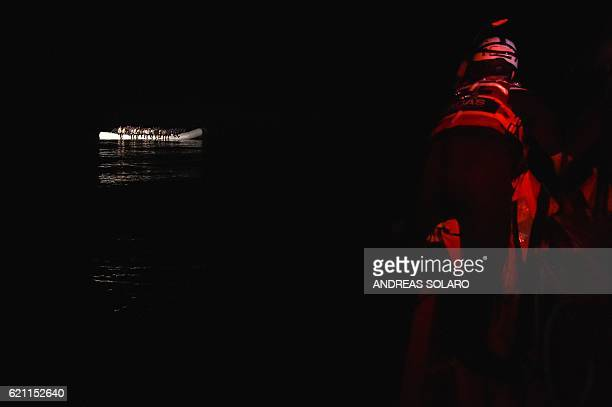 Migrants and refugee wait on a rubber raft for further instructions during a rescue operation by the Topaz Responder ship run by Maltese NGO Moas and...