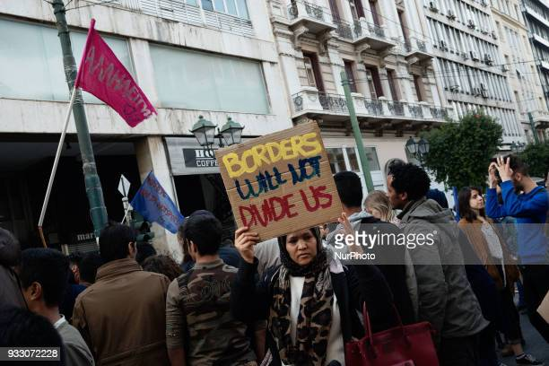 Migrants and refugees along with antiracist and political organisations march against racism in central Athens on March 17 2018 A demonstration was...