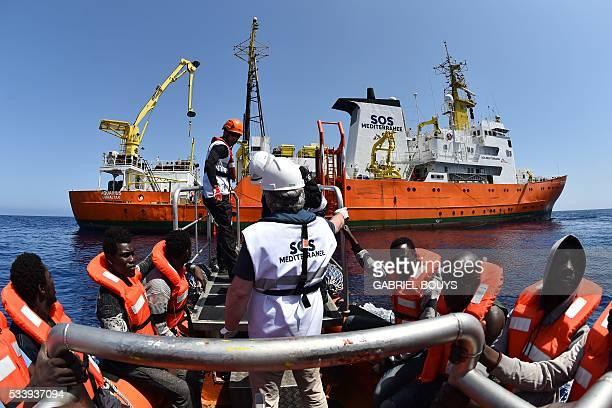 Migrants and refugees are rescued during an operation at sea with the Aquarius a former North Atlantic fisheries protection ship now used by...