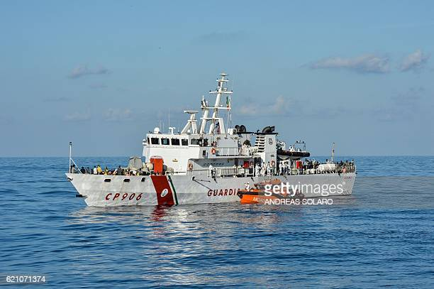 Migrants and refugees are transferred from the Topaz Responder a ship run by Maltese NGO Moas and the Italian Red Cross to the Italian Coast Guards...
