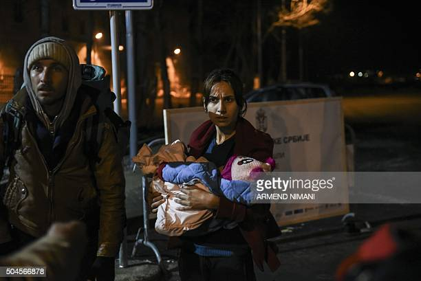 Migrants and refugees arrive on January 11, 2016 at a registration camp in southern Serbian town of Presevo, after crossing the Macedonian border....
