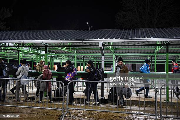 Migrants and refugees arrive on January 11 2016 at a registration camp in southern Serbian town of Presevo after crossing the Macedonian border More...
